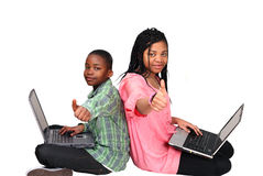 Thumbs up - cute kids on laptops Stock Photography