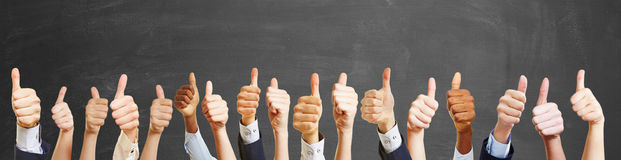 Thumbs up from different people Stock Photo