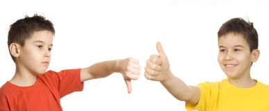 Thumbs up/down. Debate/conflict concept with thumb up/down sing Royalty Free Stock Photos
