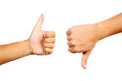 Thumbs Up And Down. In isolated white background Stock Images