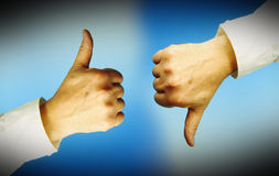 Thumbs up and down Royalty Free Stock Photo