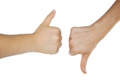 Thumbs up and down. Isolated on white background Royalty Free Stock Photo