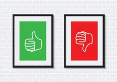 Thumbs up and down picture frames Royalty Free Stock Images