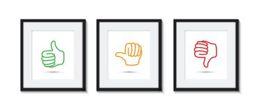 Thumbs up and down in picture frames Stock Photos