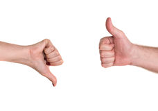 Thumbs up and down showing disagreement Royalty Free Stock Photo