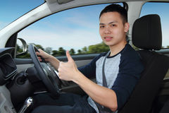 Thumbs up driving Stock Photos