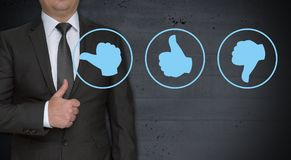 Thumbs up for evaluation concept and businessman.  stock images