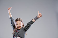 Thumbs up everybody says the girl Royalty Free Stock Photo