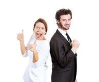 Thumbs up excited couple Stock Image