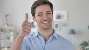 Thumbs Up by Excited Handsome Young Man stock footage