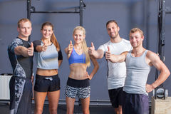 Thumbs up - fitness people showing gesture Stock Image