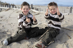 Thumbs up for the fun, boys! Royalty Free Stock Photo