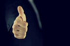 Thumbs up gesture of approval and success Royalty Free Stock Images