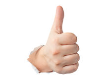 Thumbs up gesture showing through the paper. Isolated royalty free stock photography