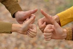 Thumbs up gesturing Royalty Free Stock Photo