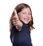 Thumbs Up Girl. A cute little girl smiles while giving a thumbs up Stock Photo