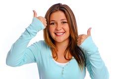 Thumbs up girl Stock Image
