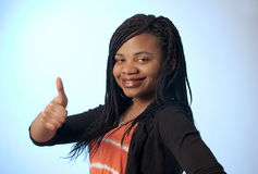 Thumbs up girl Stock Photography