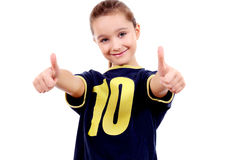Thumbs up! Girl in sport's shirt Royalty Free Stock Image