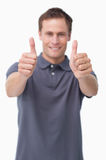 Thumbs up given by smiling young man Royalty Free Stock Photo