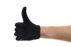 Thumbs up with glove Royalty Free Stock Image