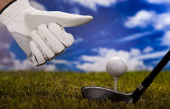 Thumbs up on golf. Golf club and ball in grass Royalty Free Stock Photography