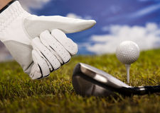 Thumbs up on golf. Golf club and ball in grass Royalty Free Stock Images