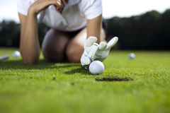 Thumbs up on golf. Girl playing golf, bright colorful vivid theme Royalty Free Stock Images