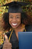Thumbs up Graduate. Female graduate with thumbs up Royalty Free Stock Photo