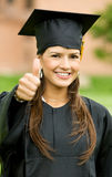 Thumbs up graduation woman Stock Photo