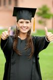 Thumbs up graduation woman Royalty Free Stock Photos
