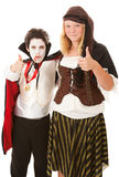 Thumbs Up for Halloween. Brother and sister in their halloween costumes, giving thumbs up signs. Isolated on white royalty free stock images