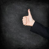Thumbs up hand on blackboard / chalkboard royalty free stock image
