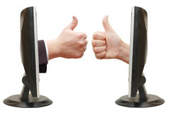 Thumbs up hand from the monitor Stock Image