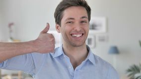 Thumbs Up by Handsome Young Man Looking at Camera stock footage