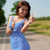 Thumbs up & happy beautiful woman outdoors Royalty Free Stock Photo