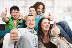 Thumbs up - happy young people Royalty Free Stock Photo