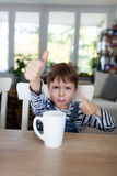 Thumbs up for healthy refreshment Stock Images