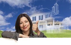 Thumbs Up Hispanic Woman with Ghosted House Drawing Behind Royalty Free Stock Photos