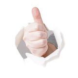 Thumbs up through hole in paper Royalty Free Stock Photo