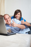 Thumbs up at home! Stock Photos