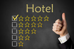 Thumbs up hotel rating stars Royalty Free Stock Photography