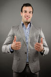 Thumbs Up. Image of a young business man giving a thumbs up sign Stock Image