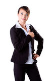 Thumbs up for a job well done. A young female business executive with thumbs up Royalty Free Stock Image