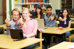 Thumbs up in library Royalty Free Stock Photography