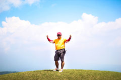 Thumbs up. A male golfer gives the thums up as he stands on top of a hill Royalty Free Stock Image