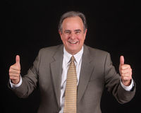 Thumbs up - mature businessman Stock Photo