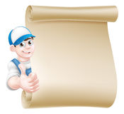 Thumbs up mechanic scroll. A cartoon mechanic, plumber, handyman, decorator or gardener leaning around a scroll and giving a thumbs up Stock Photos