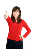 Thumbs up mixed race girl in red Royalty Free Stock Photo