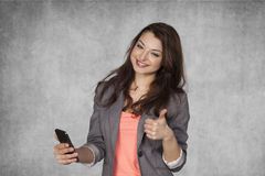 Thumbs up for mobile phone Stock Photography